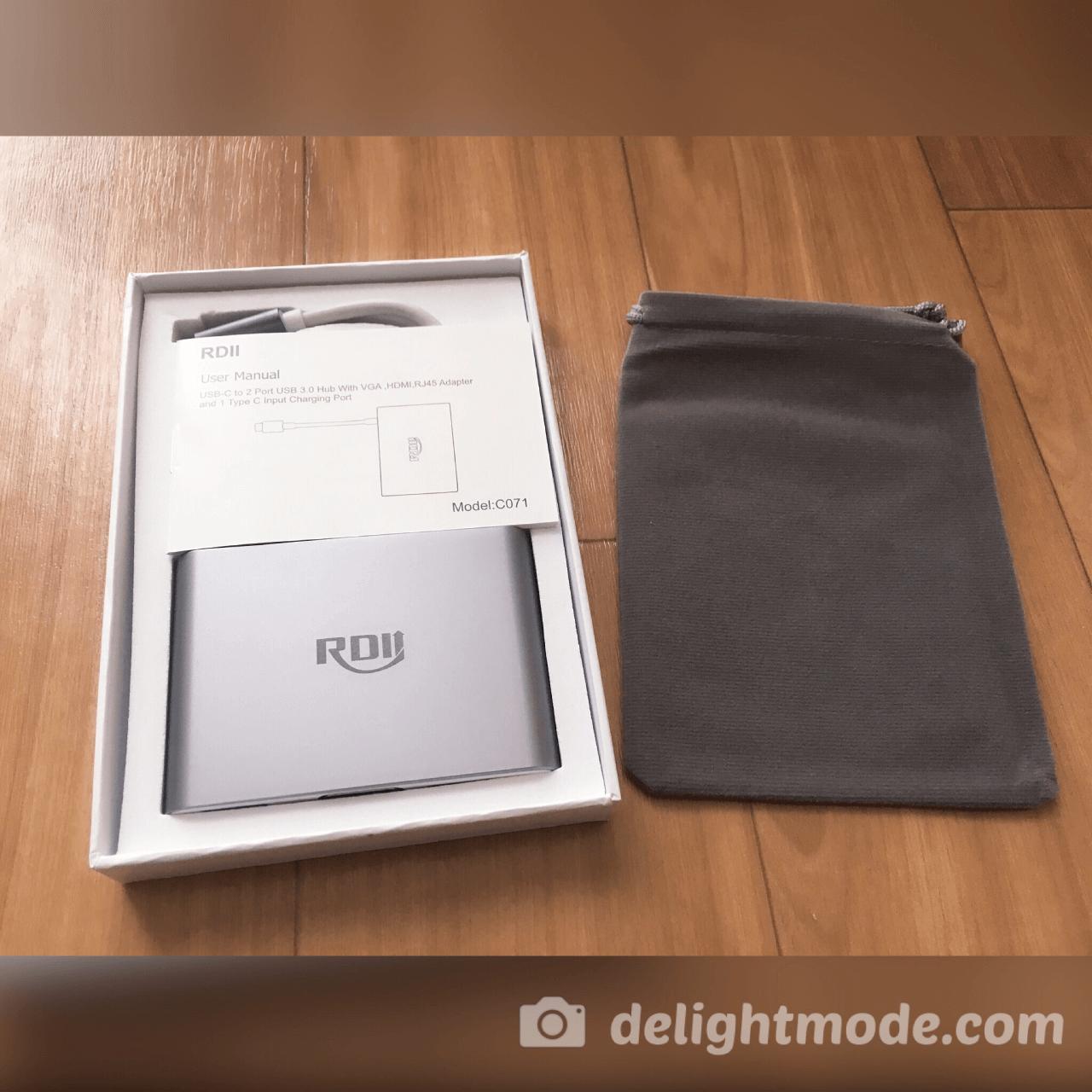 USB-Cマルチポート(6 in 1)ハブ「RDII C071」の開封写真です。収納ポーチと本体、説明書があります。